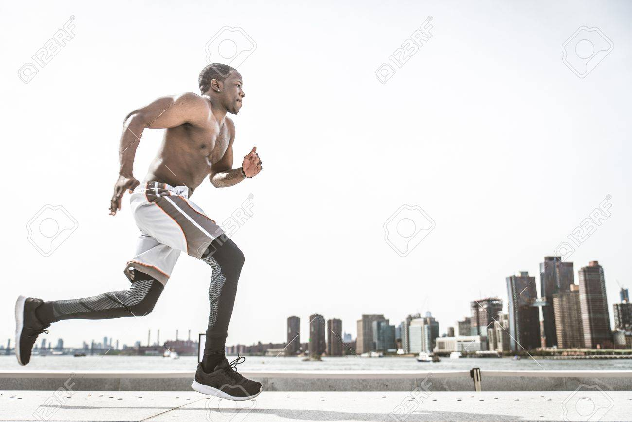 fb5fc106d0b4 Sportive man training outdoors - Runner jogging, healthy lifestyle and sport  concept Stock Photo -
