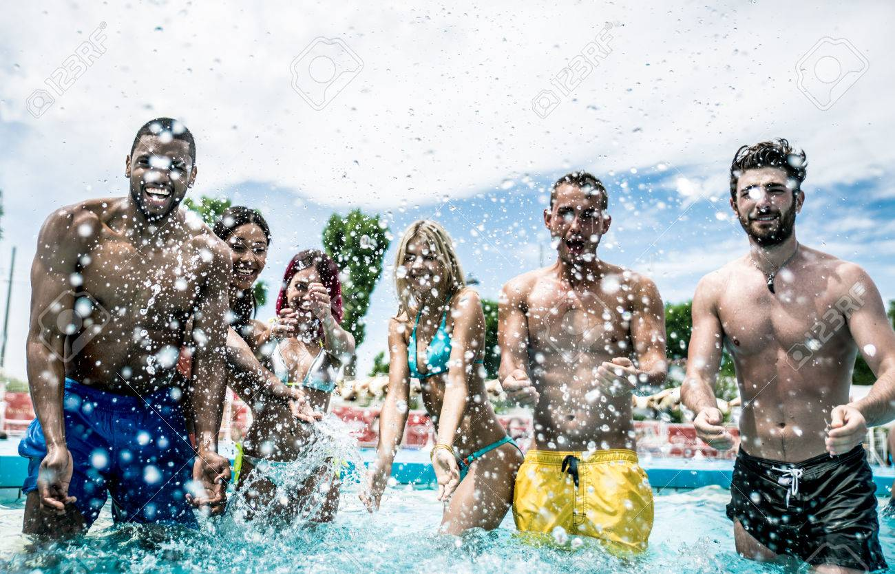 Group of friends making party in the pool - 66918039