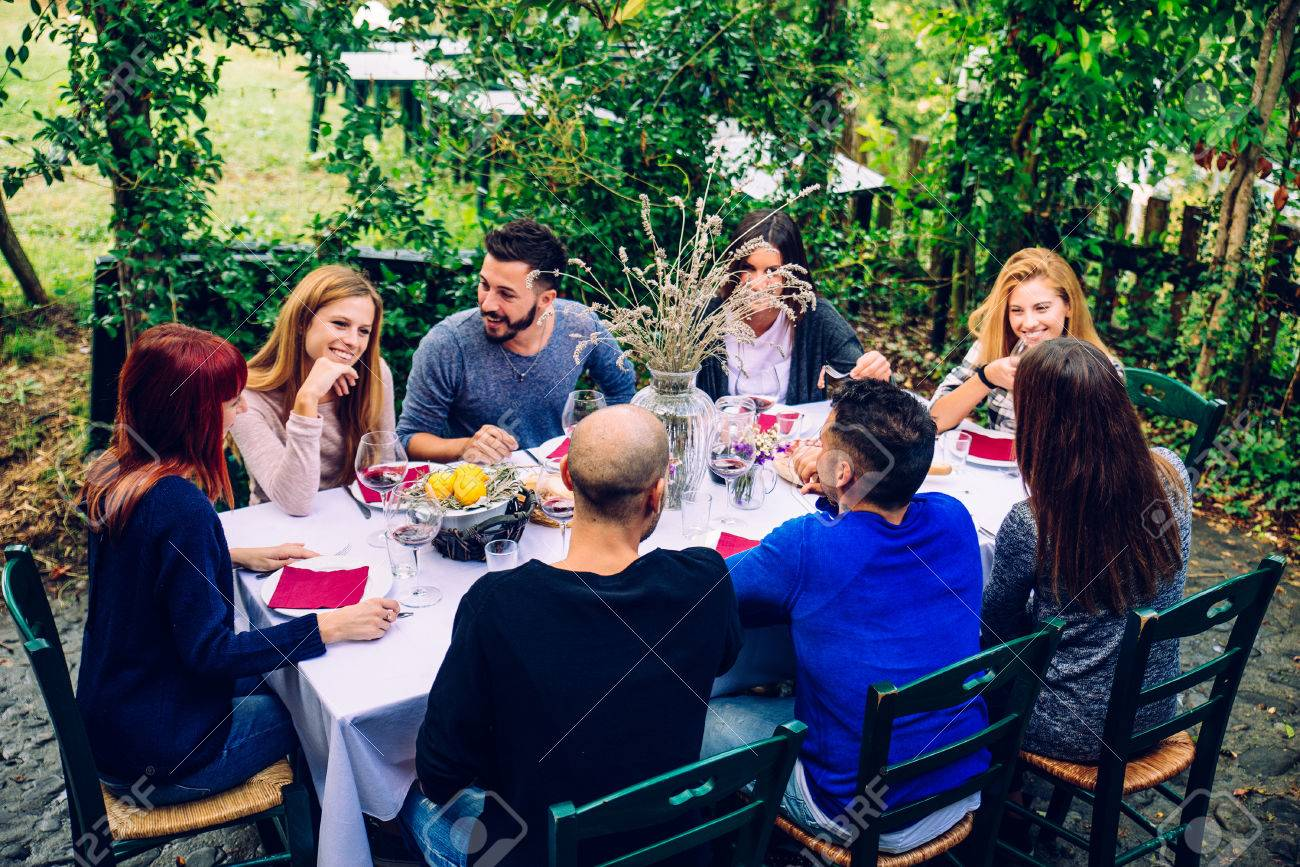 Group of friends at restaurant outdoors - People having dinner in a home garden - 69031036