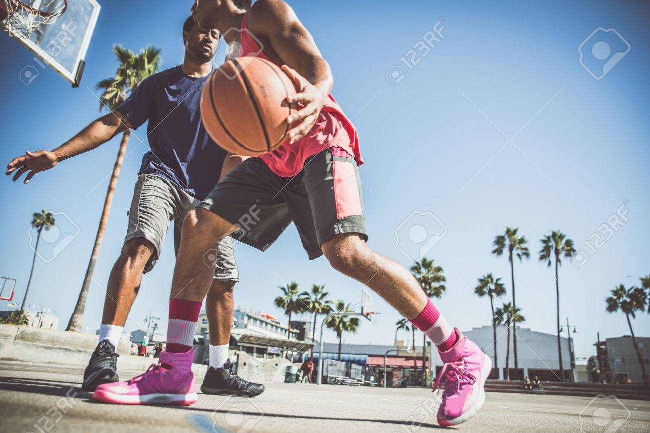 Two basketball players playing outdoor in LA Stock Photo - 71078499