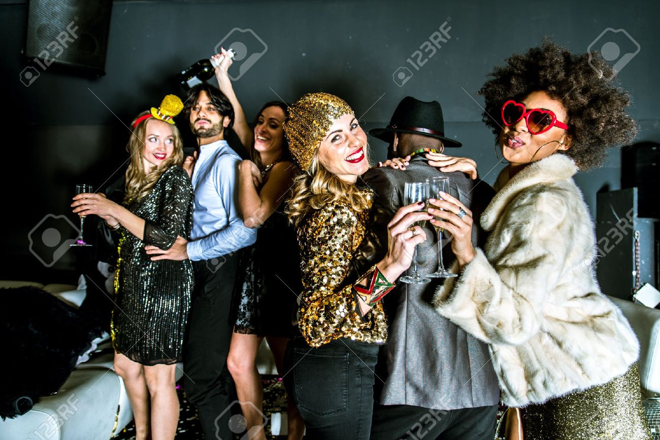 Multi-ethnic group of friends celebrating in a nightclub - Clubbers having party - 71078097