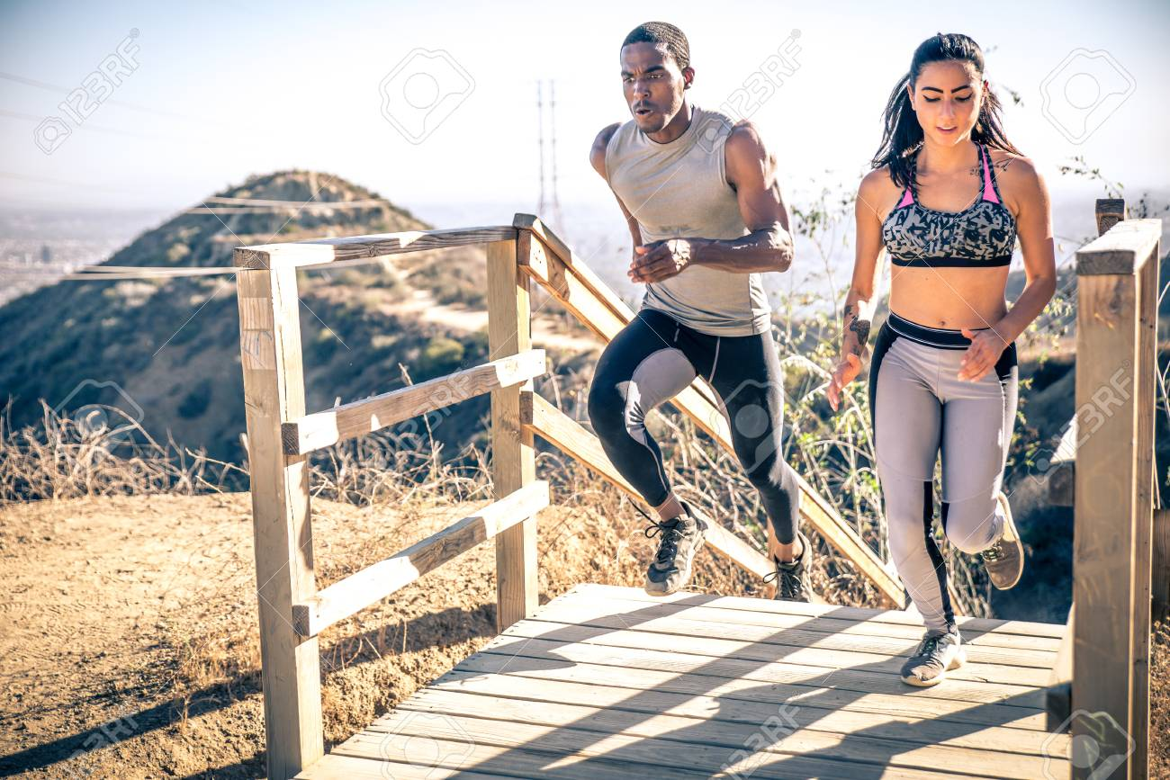 c0fbe31619d6c Couple running in los angeles canyons. making exercises after run Stock  Photo - 74316240