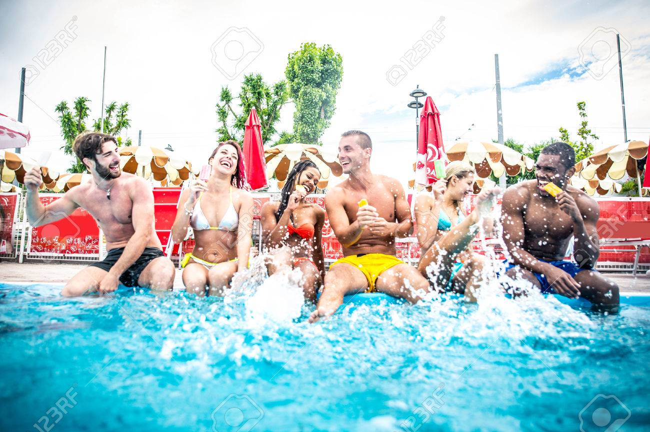 Multi Ethnic Group Of Friends In A Swimming Pool
