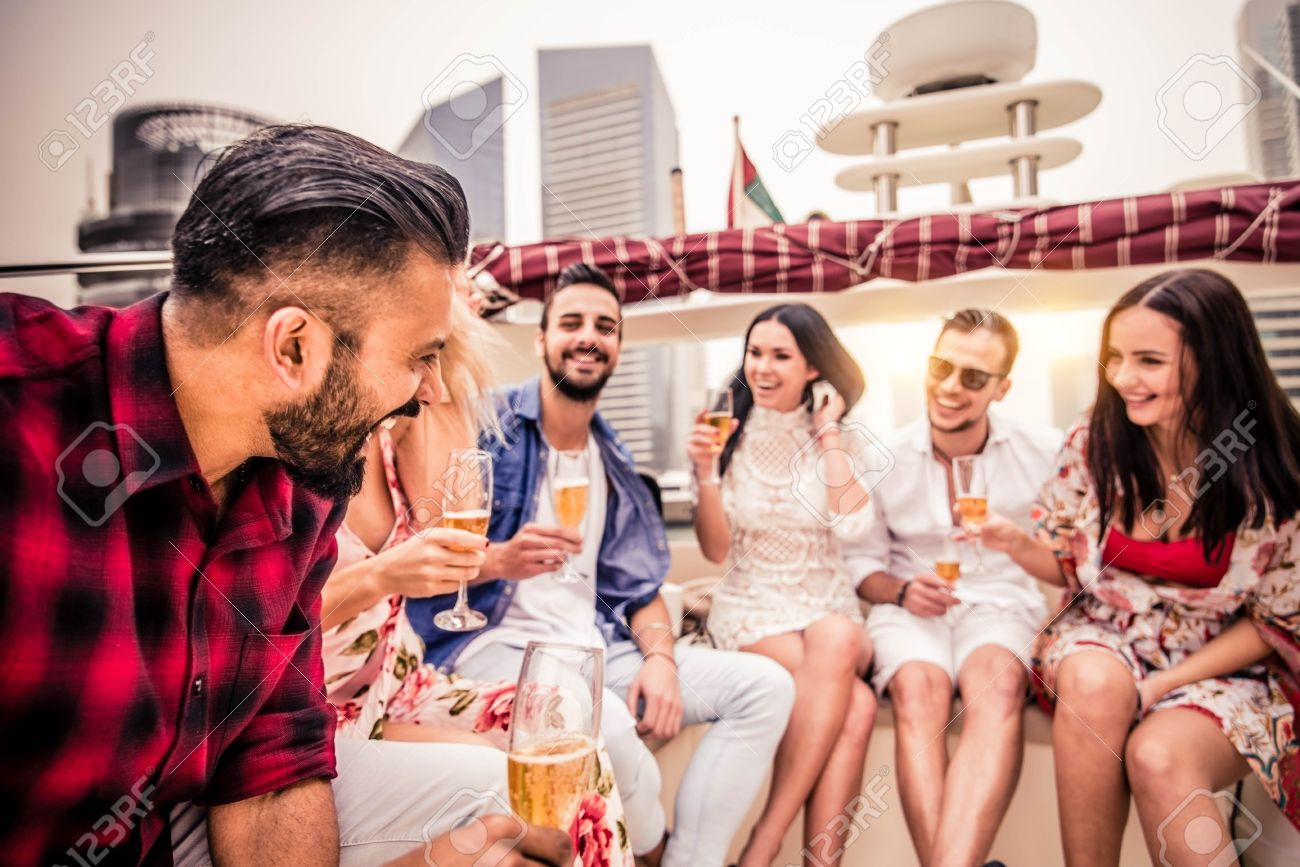 group of friends making party on a yacht in dubai happy people
