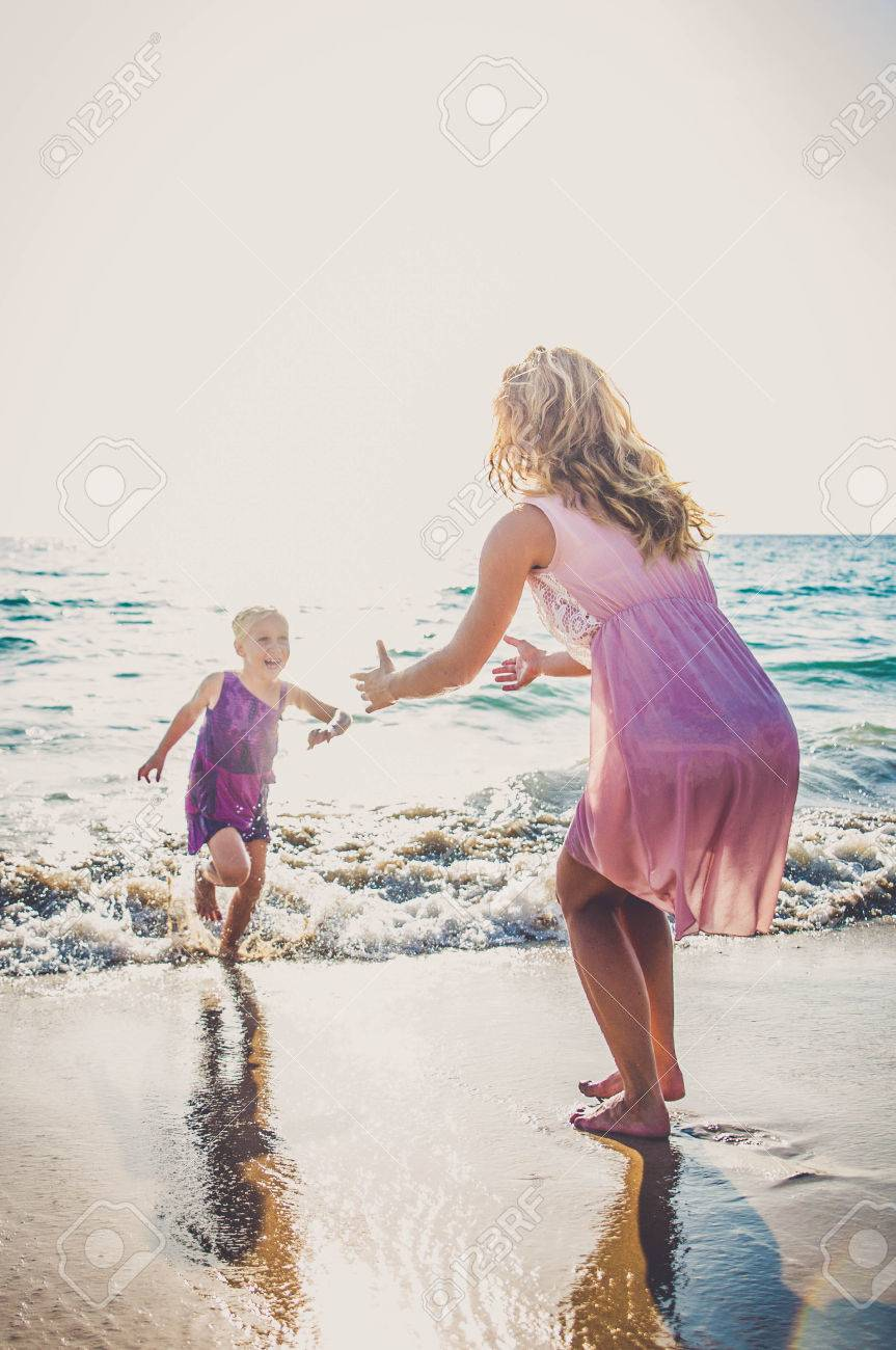 happy family mother and child daughter run laugh and play at
