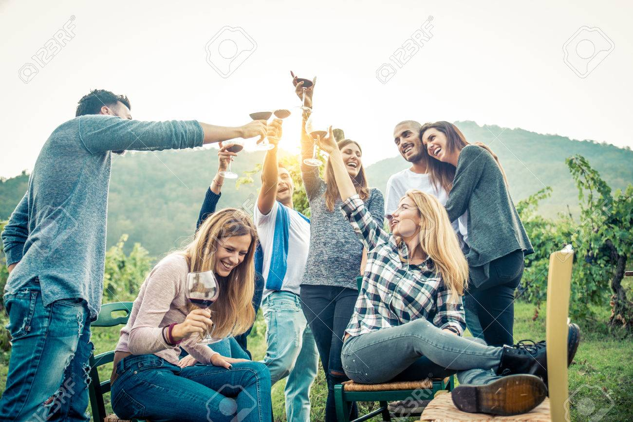 Group of friends at restaurant outdoors - People having dinner in a home garden - 81940596