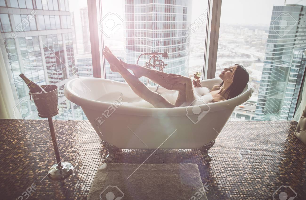 Seductive woman taking relaxing bath in her jacuzzi - 93410525