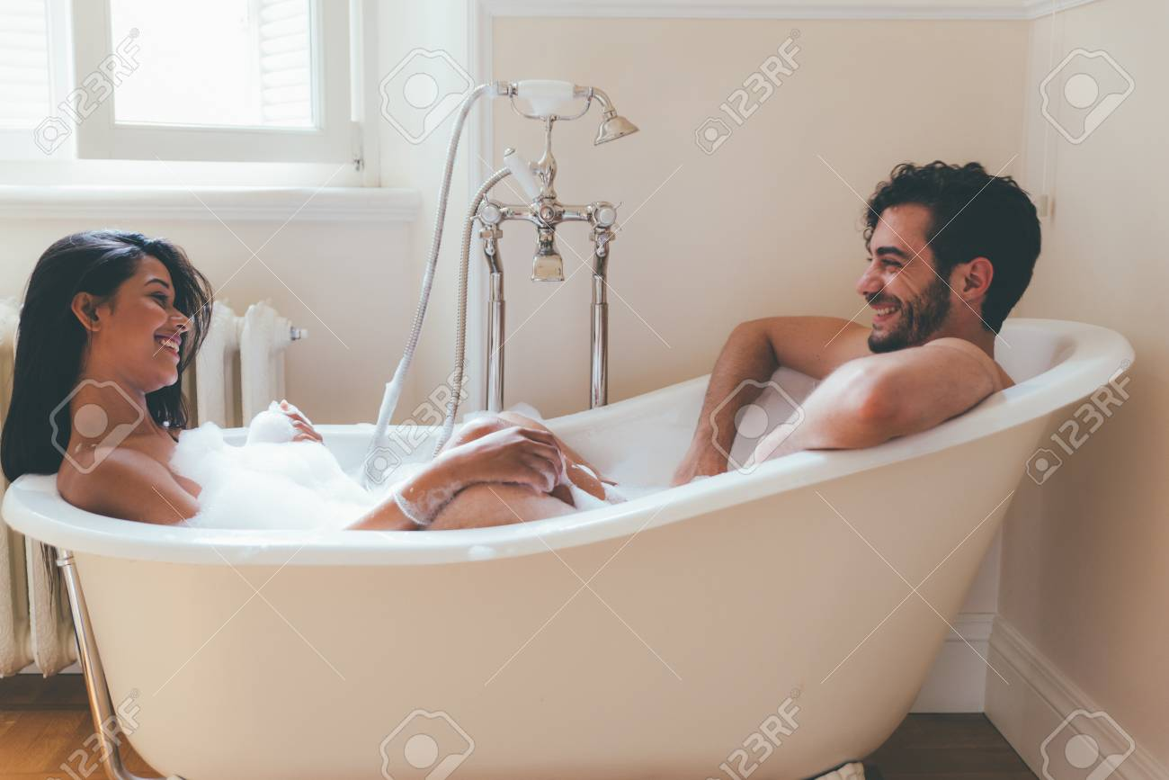 Couple in love spending time together in the house. Romantic moments in the bathroom - 106721706