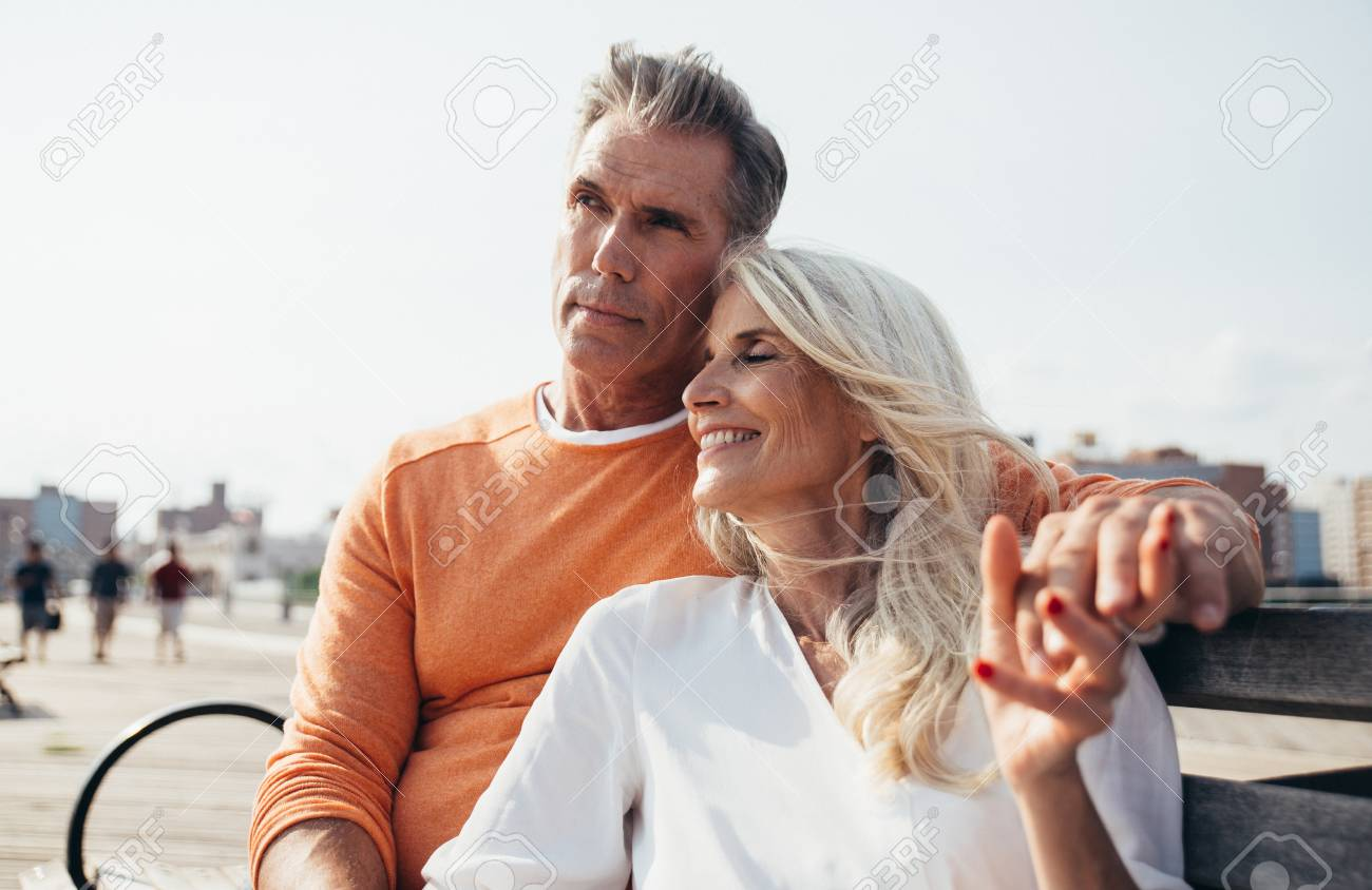 Happy senior couple spending time at the beach. Concepts about love,seniority and people - 111345578