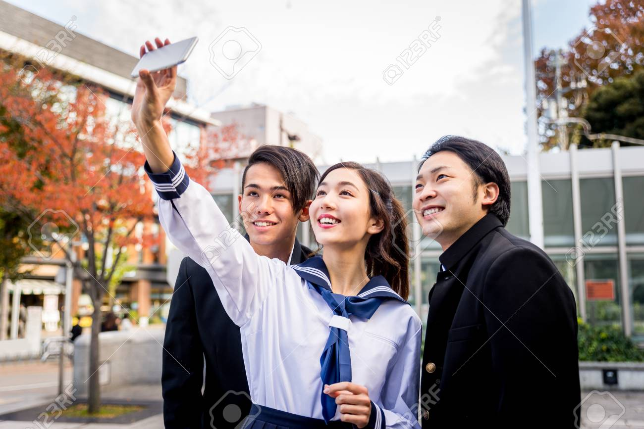 Yung japanese students with school uniform bonding outdoors - Group of asian teenagers having fun - 114243756