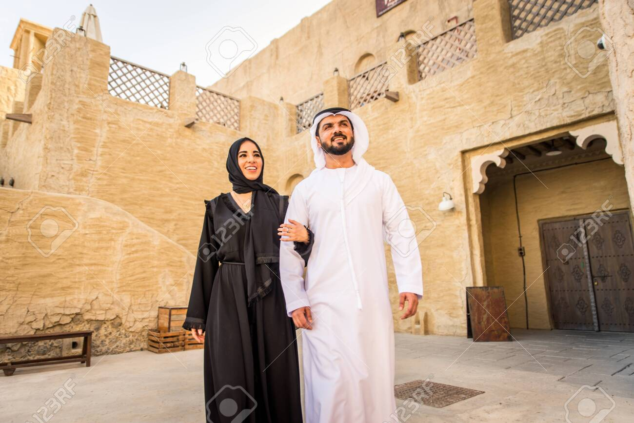 Arabian couple with traditional emirates dress dating outdoors