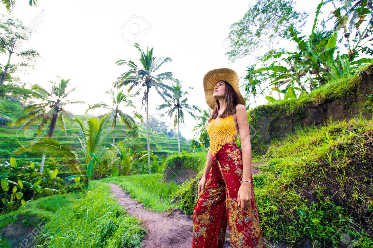 Young woman on green cascade rice field plantation at Tegalalang terrace. - 127244891