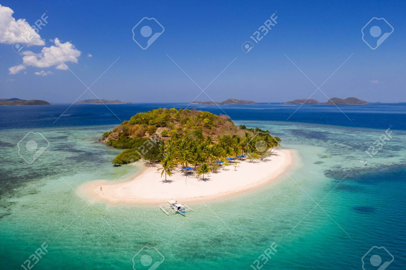 Tropical Island with blue water - 128454170