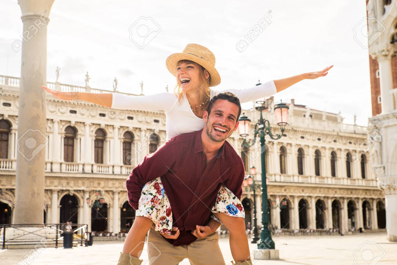 Beatiful young couple having fun while visiting Venice - Tourists travelling in Italy and sightseeing the most relevant landmarks of Venezia - Concepts about lifestyle, travel, tourism - 150845240