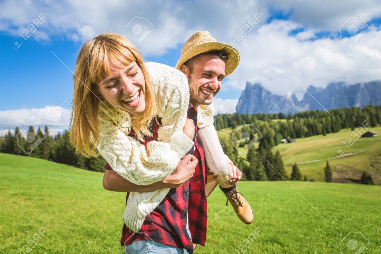 Beautiful young couple traveling in the Dolomites, Italy - Two lovers having a day trip in the nature - 156455691