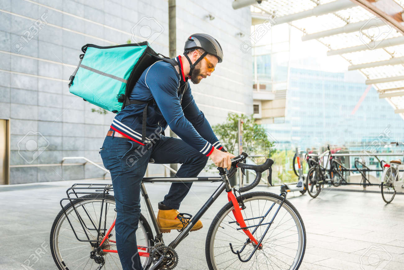 Food delivery service, rider delivering food to clints with bicycle - Concepts about transportation, food delivery and technology - 159592323