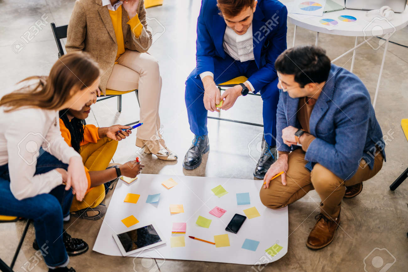 Project managers and employees brainstorming on ideas - Multi-ethnic group of workers having business meeting in a start-up office - 168140608