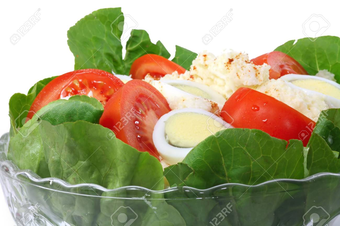 A bowl of potato salad with tomato wedges and sliced eggs. - 3367632