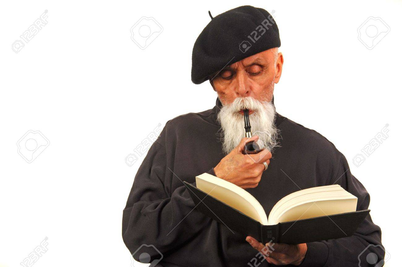 An elderly man smoking a pipe and reading a book. Stock Photo - 4085613