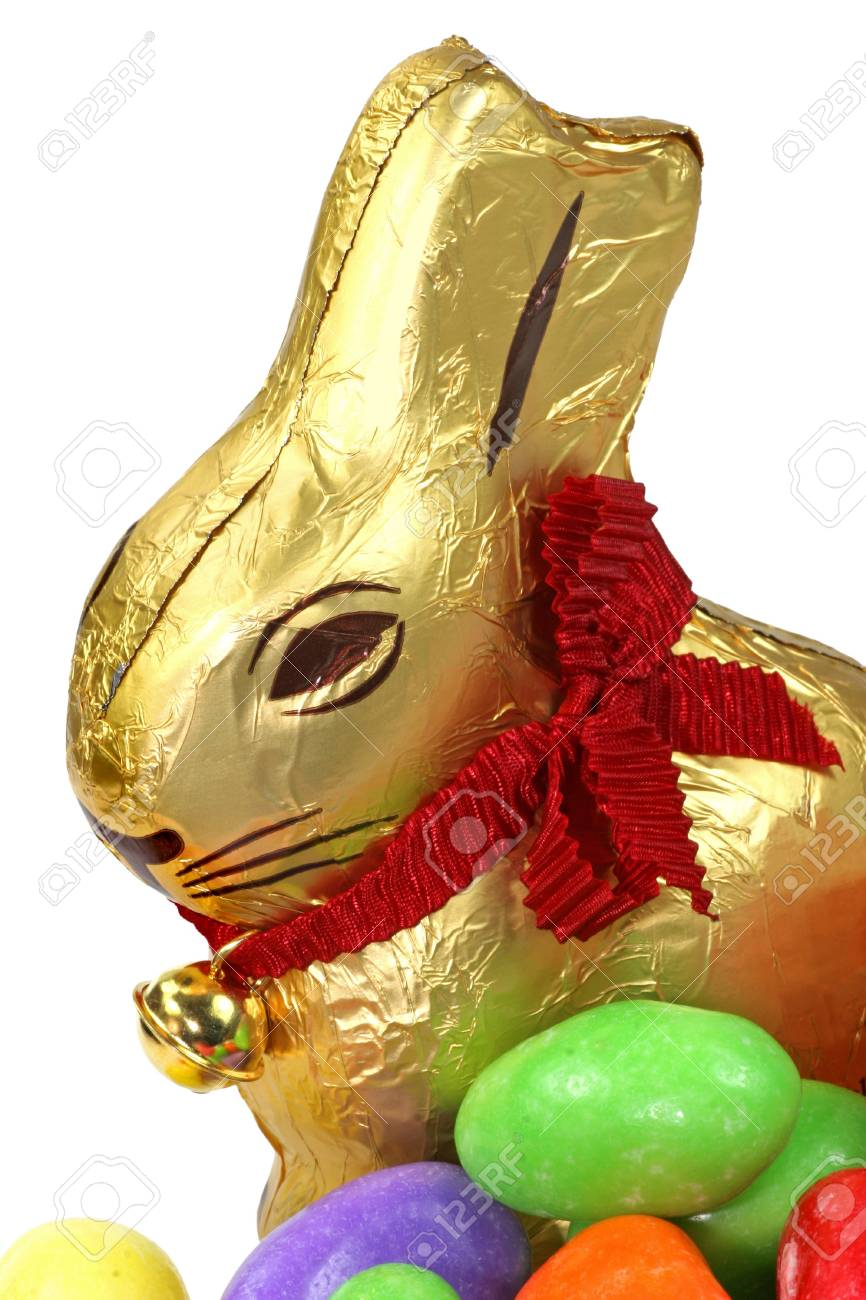 A golden Easter Bunny and egg shaped candies. Stock Photo - 4223095