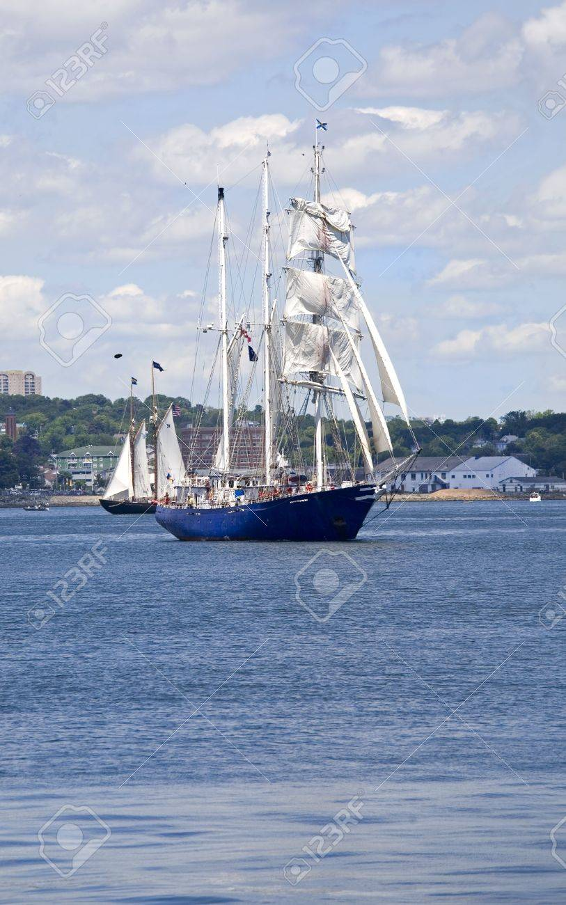 Tall ships sailing around Halifax Harbour during the sail past in the Nova Scotia Tall Ship Festival. Stock Photo - 5257786