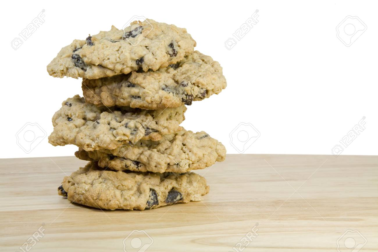 A stack of homemade oatmeal raisen cookies on a wooden platter. Stock Photo - 5311101