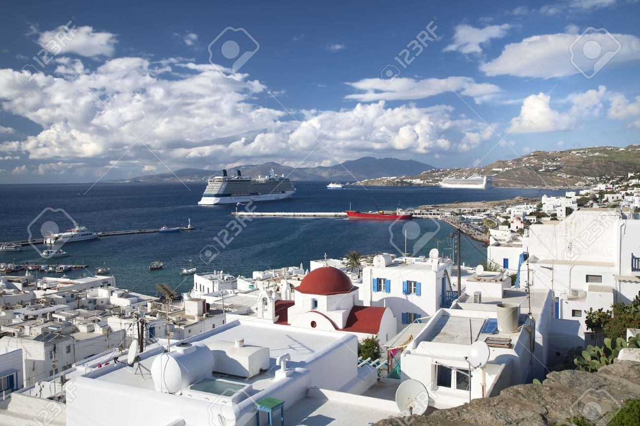 Cruise ships docked at a port on the shoreline of Mykonos, Greece. - 7894854