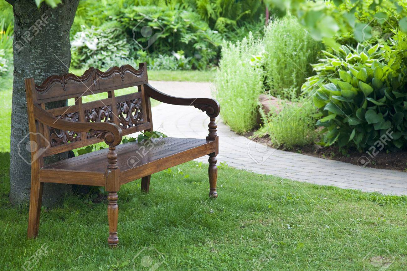 Fine A Carved Teak Bench In The Shade Of A Tree In A Tranquil Garden Creativecarmelina Interior Chair Design Creativecarmelinacom