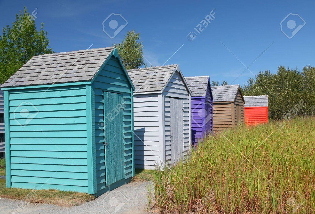 A Row Of Brightly Colored Small Garden Sheds. Stock Photo   9529131