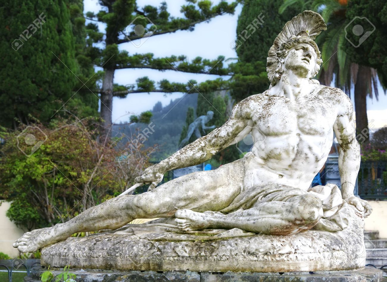 Statue of Achilles dying, shot in the foot with an arrow. Located in the gardens of the Achillion Palace, Corfu, Greece. - 9673458