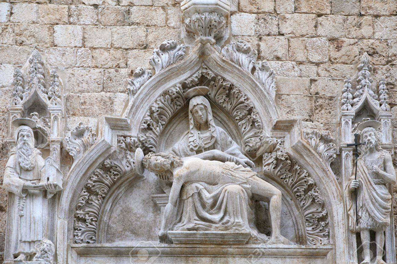 Statue of Our Lady of Sorrow on the portal of the Franciscan church of the Friars Minor, St. Saviour Church, in Dubrovnik. Completed in 1528. - 9970766