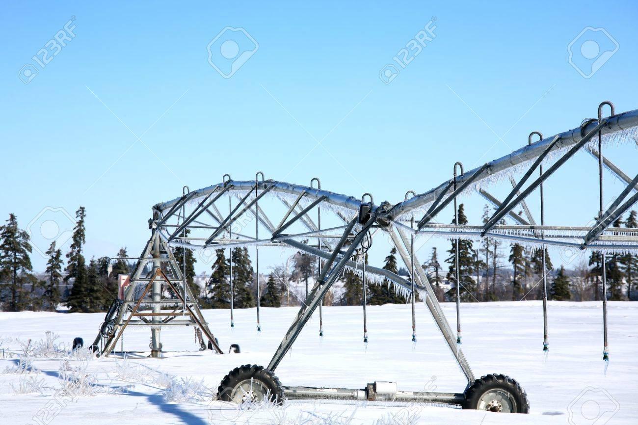 Industrial irrigation equipment on farm field in rural Prince Edward Island, Canada - 10597464