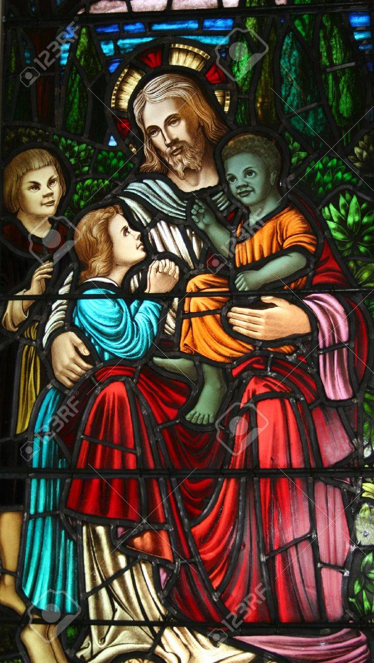 stained glass pictorial of jesus and the children stock photo