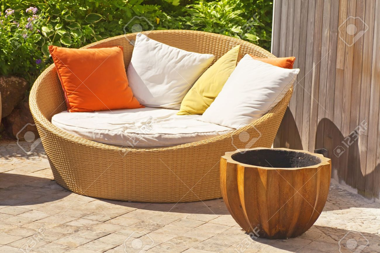 a modern wicker garden sofa or love seat in the home garden stock photo