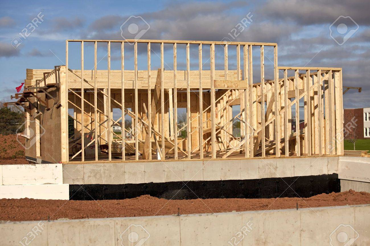 Construction of a wood frame home or building with an insulated cement foundation. Stock Photo - 12889551