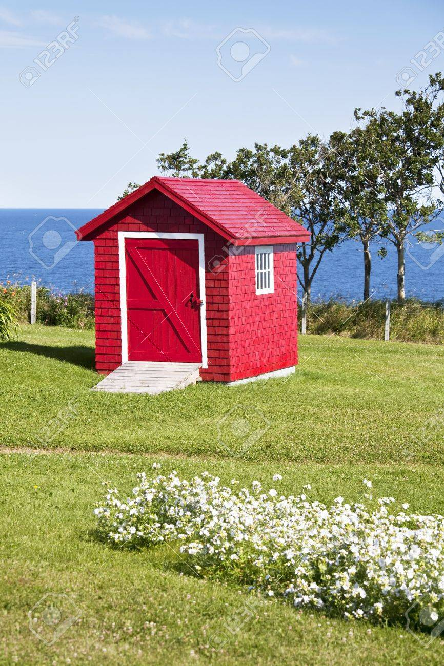 Red garden shed overlooking the ocean. Stock Photo - 13446053