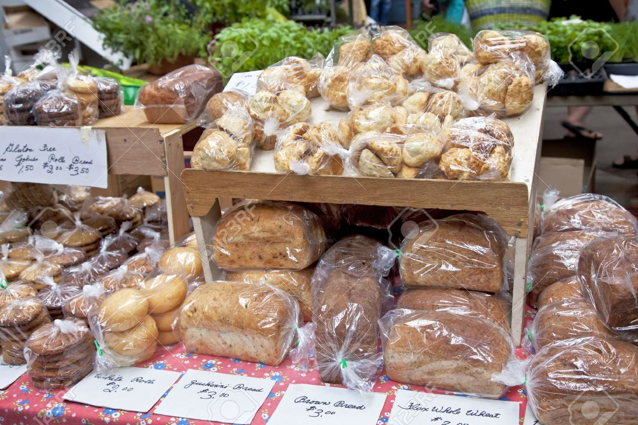 Various types of bread and other baked goods at a farmers market bake sale. Stock Photo - 14223978