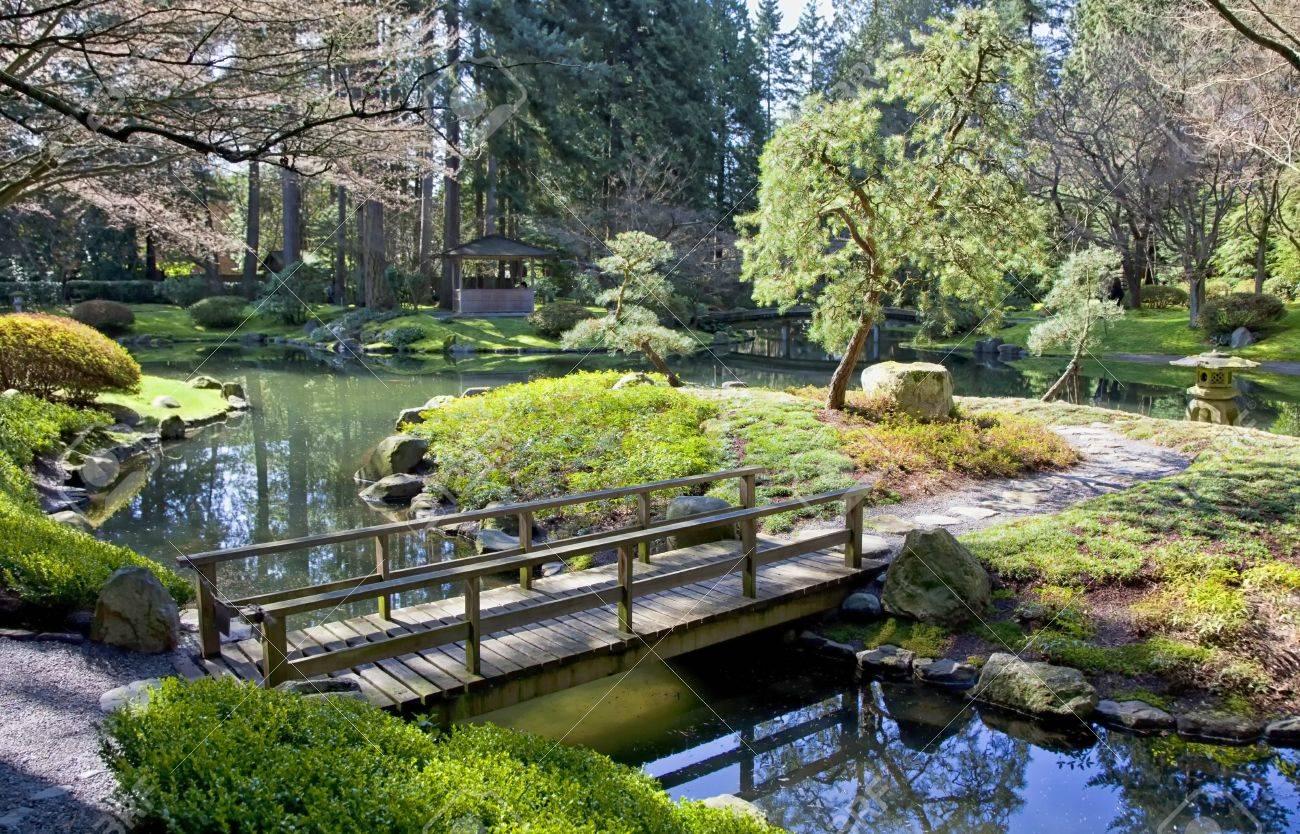 Japanese Style Garden Bridges View Of A Garden Bridge In A Tranquil Japanese Garden Stock Photo