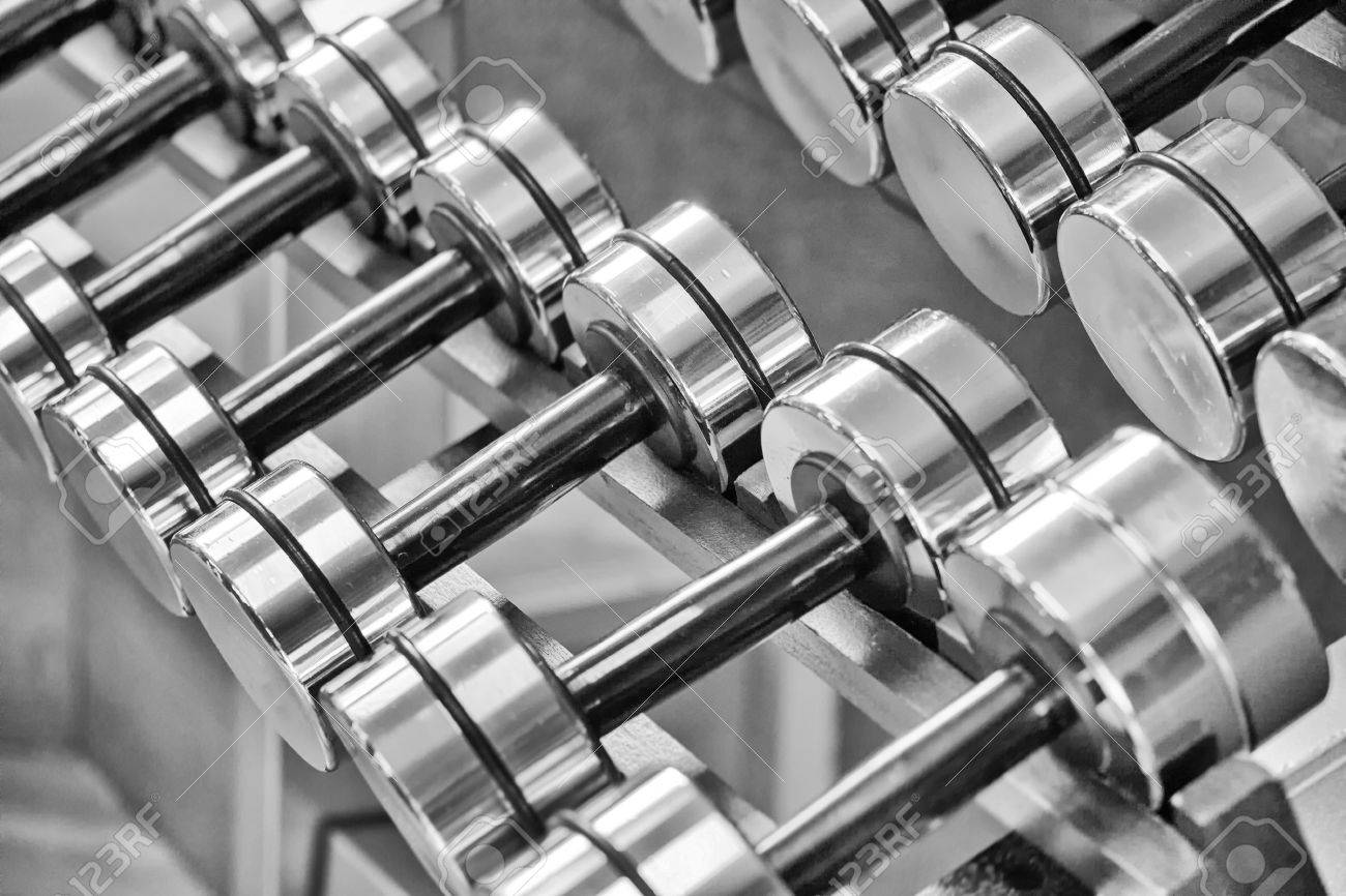 A rack of silver colored dumbells. Stock Photo - 17462472