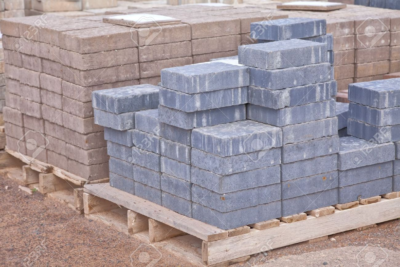 Stacks of various colored concrete pavers (paving stone) or patio blocks  organized on wooden - Stacks Of Various Colored Concrete Pavers (paving Stone) Or Patio