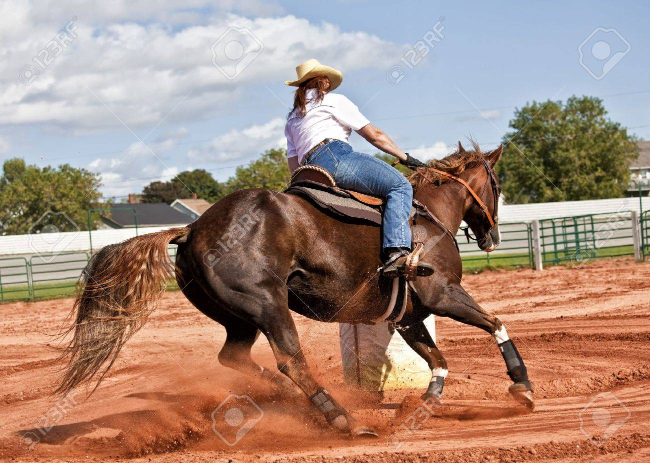 Western horse and rider competing in pole bending and barrel racing competition. Stock Photo - 18702116