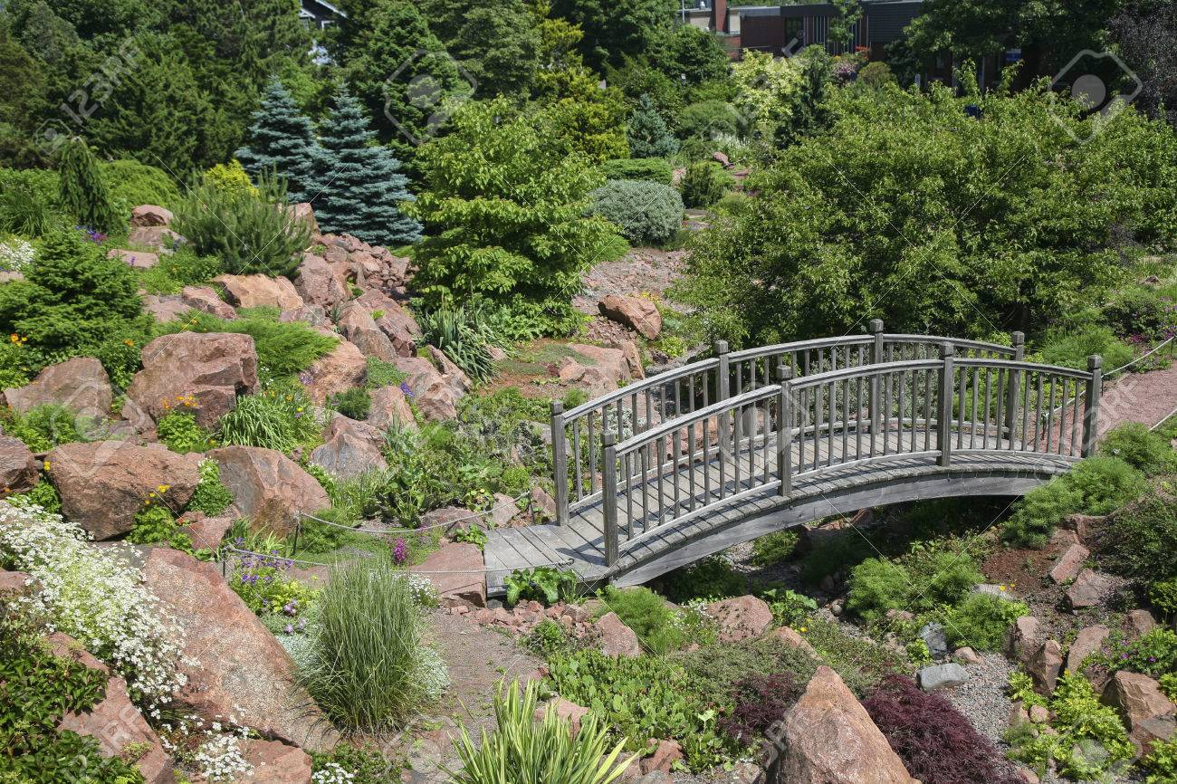 Gorgeous Wooden Garden Bridge In A Alpine Rock Garden Stock Photo Picture  With Outstanding Stock Photo  Wooden Garden Bridge In A Alpine Rock Garden With Charming Spiral Garden Hose Also Quality Diamonds Hatton Garden Review In Addition Camden Garden And Automatic Garden Watering System As Well As Chinese Covent Garden Additionally Keep Cats Away From Garden From Rfcom With   Outstanding Wooden Garden Bridge In A Alpine Rock Garden Stock Photo Picture  With Charming Stock Photo  Wooden Garden Bridge In A Alpine Rock Garden And Gorgeous Spiral Garden Hose Also Quality Diamonds Hatton Garden Review In Addition Camden Garden From Rfcom