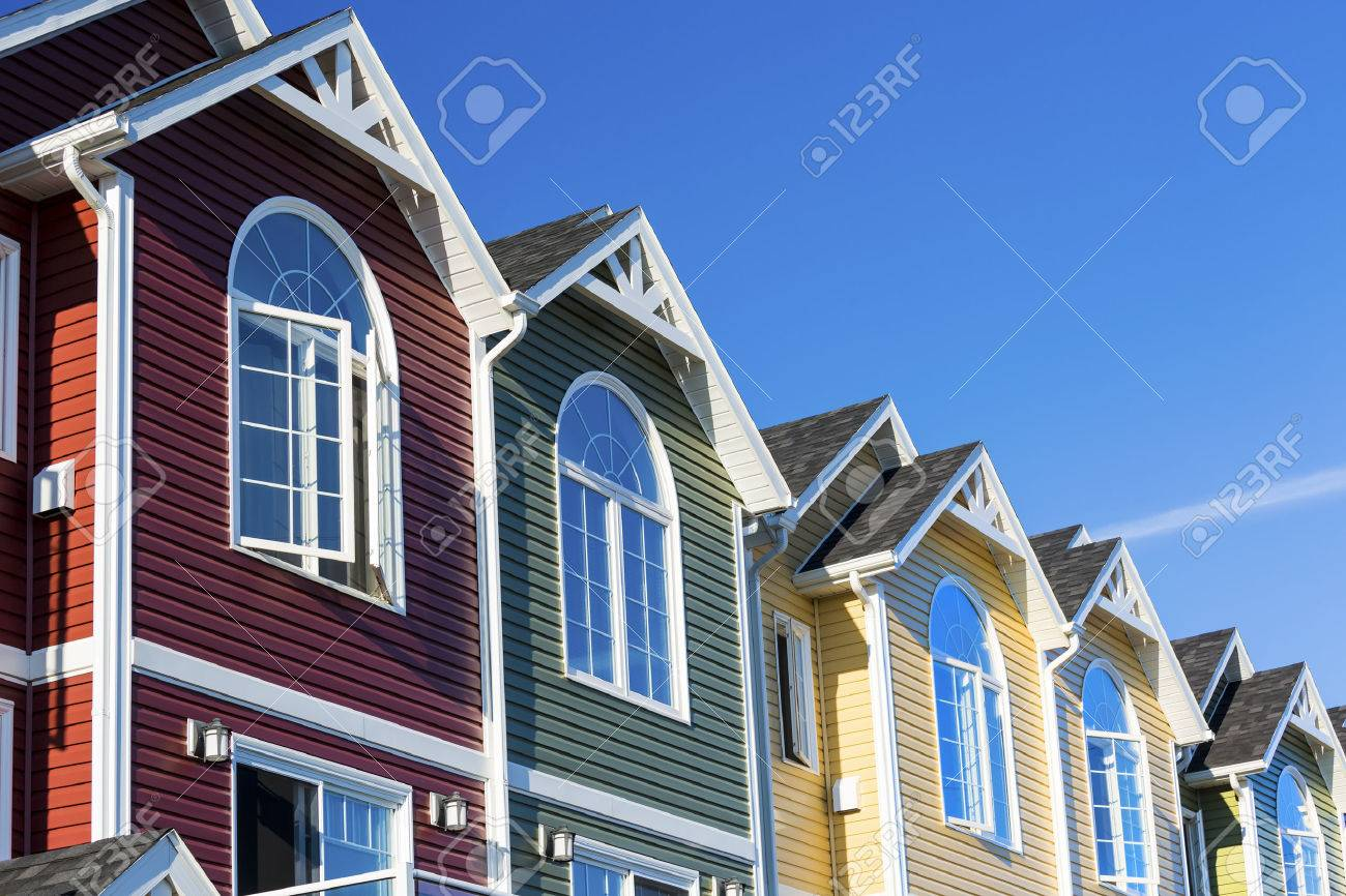 A row of colorful new townhouses or condominiums. Stock Photo - 28920589