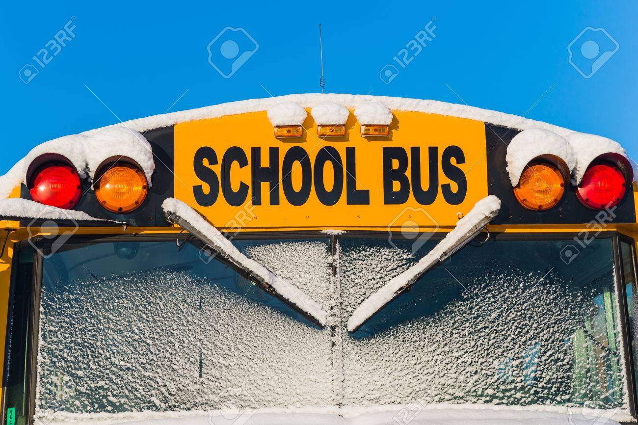 The front of a school bus after a fresh winter snowfall. Stock Photo - 43934421
