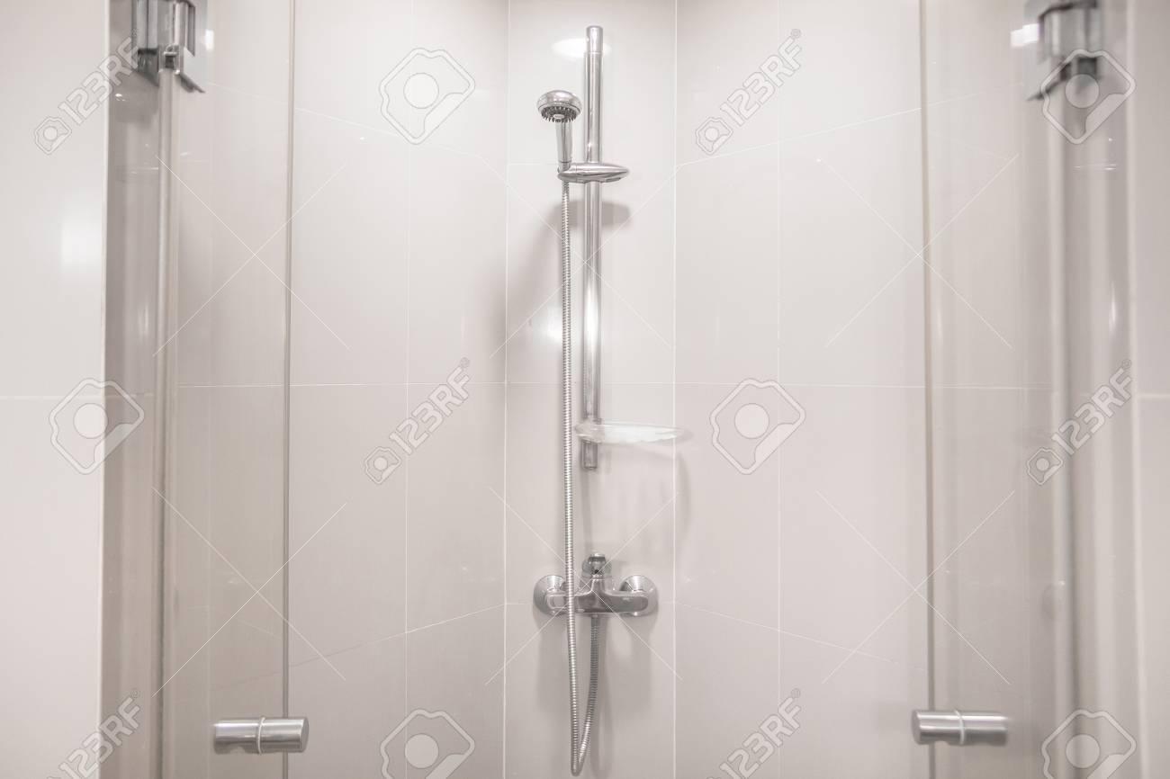 Interior of modern shower head in bathroom at home modern design of bathroom white