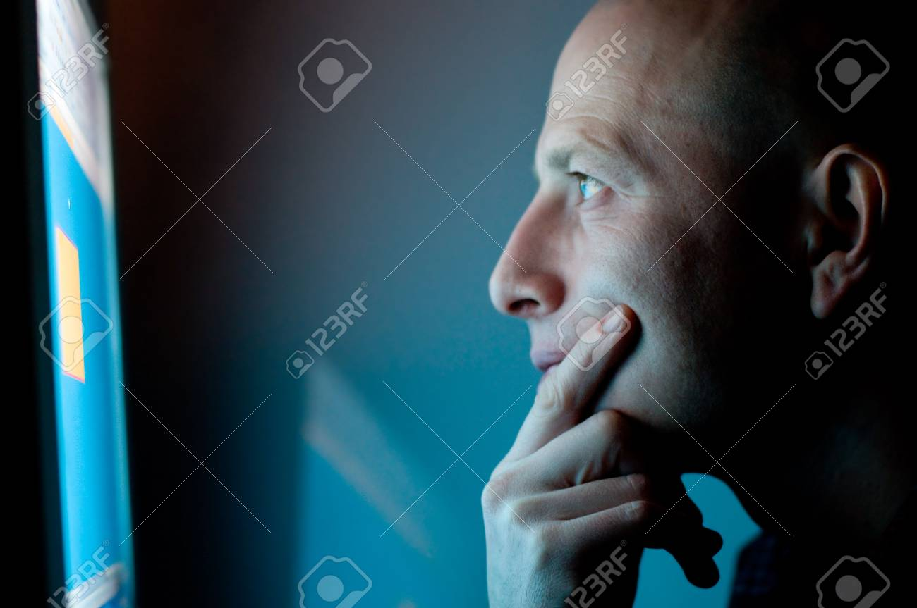 man working on computer late at night Stock Photo - 4820350