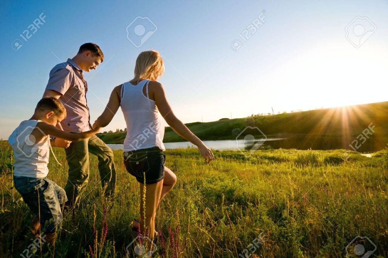 happy family having fun outdoors - 5553189