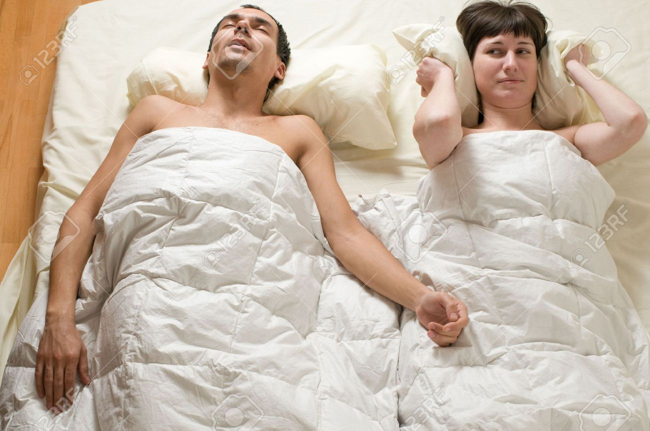 couple in bed with man snoring Stock Photo - 6303767