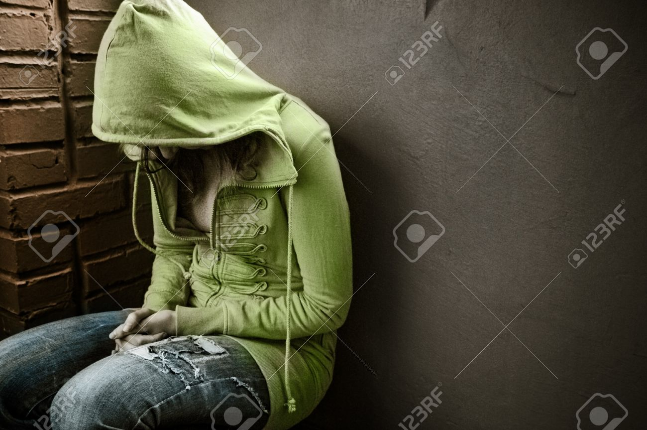 teenage girl siting against wall in a depressed state Stock Photo - 8005911