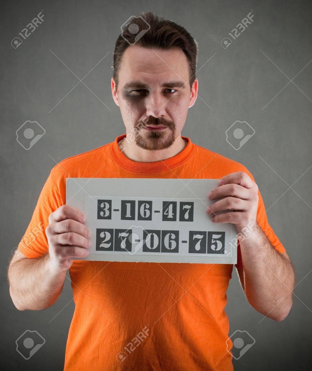 arrested man  wearing a orange jumpsuit Stock Photo - 8949648